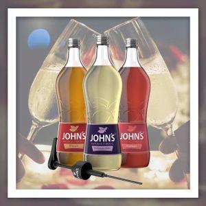 Auswahl an Getränke Sirup der Marke John´s  als Rezeptidee zu mischen im Prosecco oder Sekt